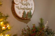 19 a winter sign with a large burlap bow, Christmas trees attached, snowflakes and calligraphy