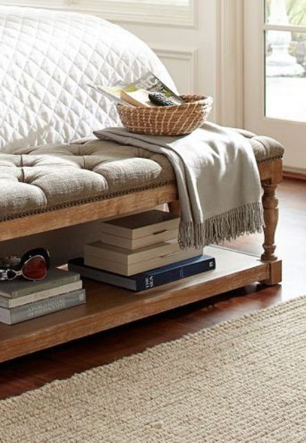 an upholstered vintage-style bench with an additional shelf inside