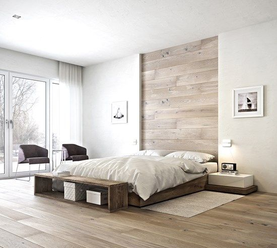 white walls are spruced up with a wood clad headboard and matching floors