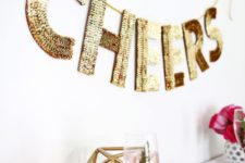 20 a gold sequin letter garland for decorating any space at home