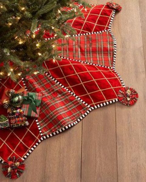 a red velvet and plaid Christmas tree skirt is all you need for a chic and cozy look