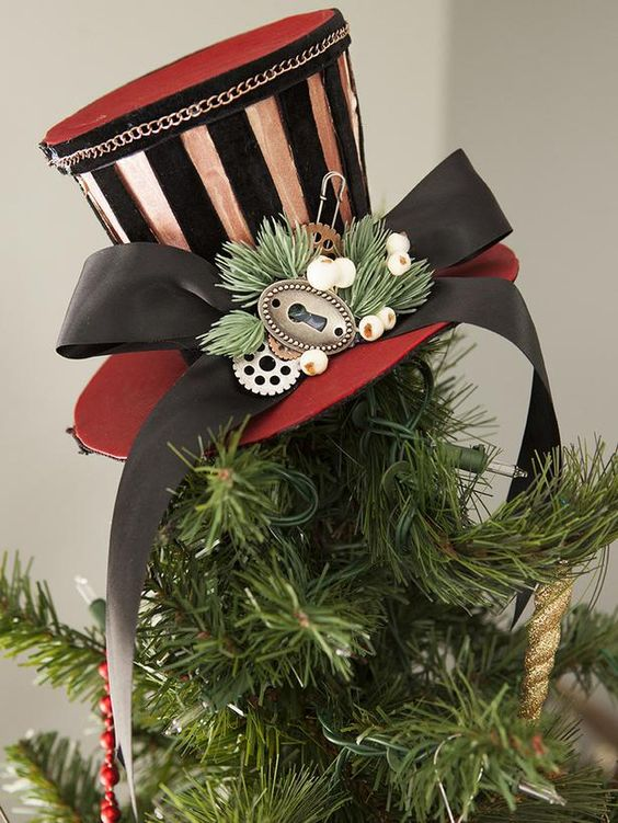 top the tree with a steampunk striped top hat with a ribbon bow and some berries