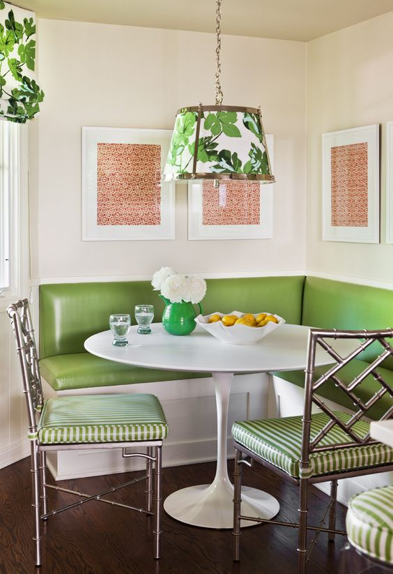 a retro diner space done in green, white and coral with botanical patterns