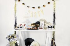 21 colorful fringe and black, gold and white balloons around will make any space party-like