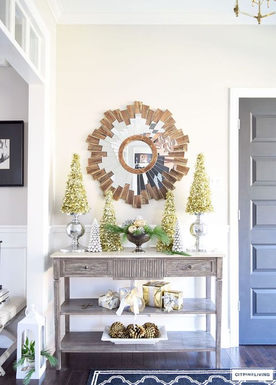 metallic trees and a bowl with evergreens and ornaments for a chic look
