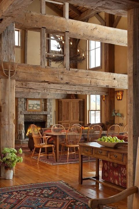 natural wooden beams, floors and even furniture in warm shades is truly barn like
