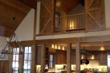 22 a real barn home with light-colored wood on the floor, ceiling and barn doors