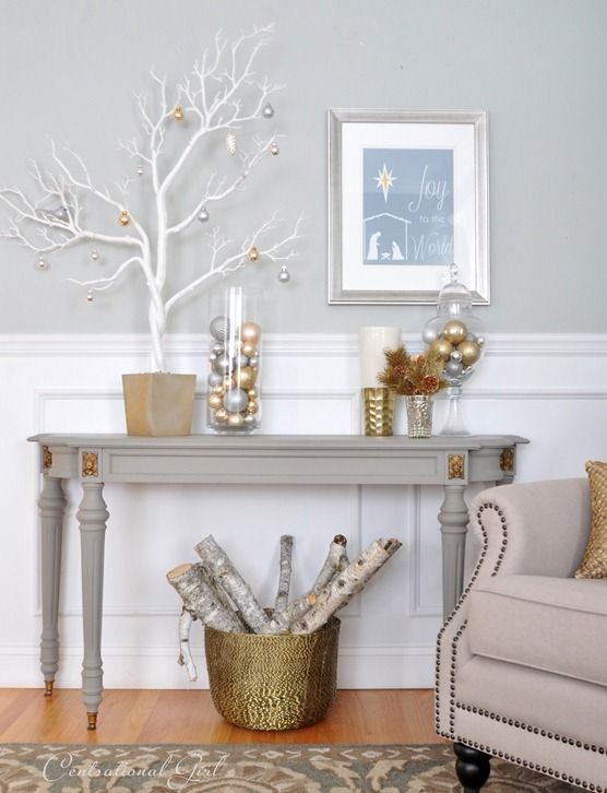 ornaments in jars, a white tree with metallic ornaments and a metallic basket with branches