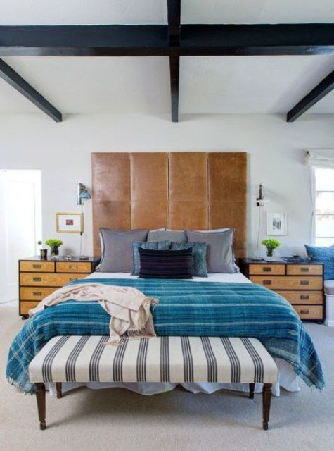 a large brown leather headboard is used as an eye-catcher in this vivacious space