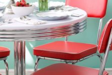 23 red retro chairs and a diner-styled round table are ideal for adding a retro feel to your space