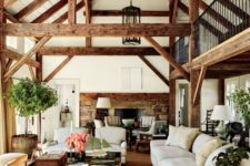 23 rich-colored wooden beams here add dimension and coziness to the space