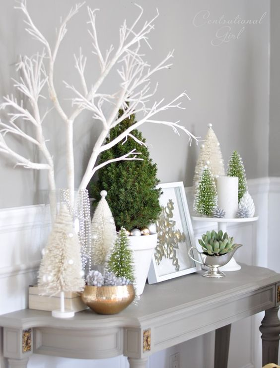 Christmas trees, ornaments, a succulent and candles for snowy styling
