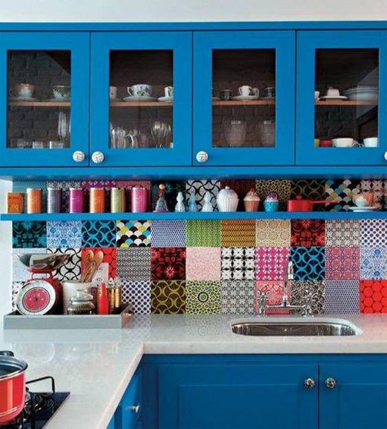 a bold blue kitchen with super colorful tiles of all kinds but the same size