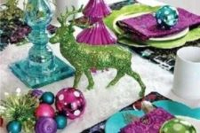 24 a colorful tablescape with ornaments, napkins and chargers of different colors and a glitter deer