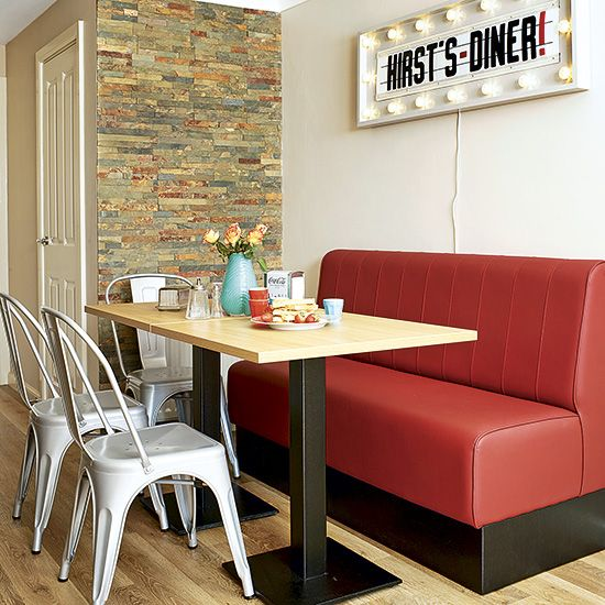 a retro dinign zone with an industrial feel, metal chairs and a marquee light sign