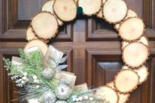 24 a wood slice Christmas wreath with silver frozen apples, faux greenery and berries