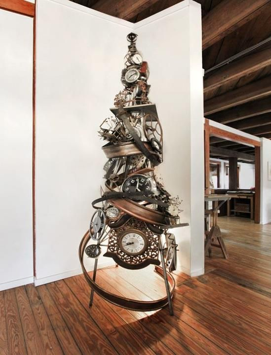 a unique steampunk Christmas tree with clocks, gears and metal elements looks just jaw-dropping