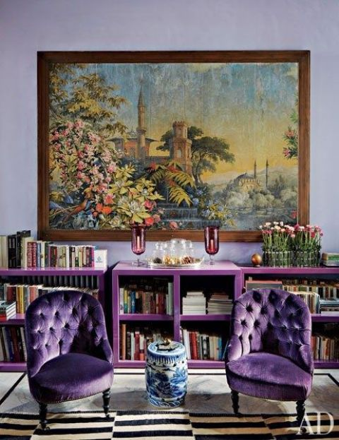 violet upholstered chairs and a matching bookshelf for an exquisite space