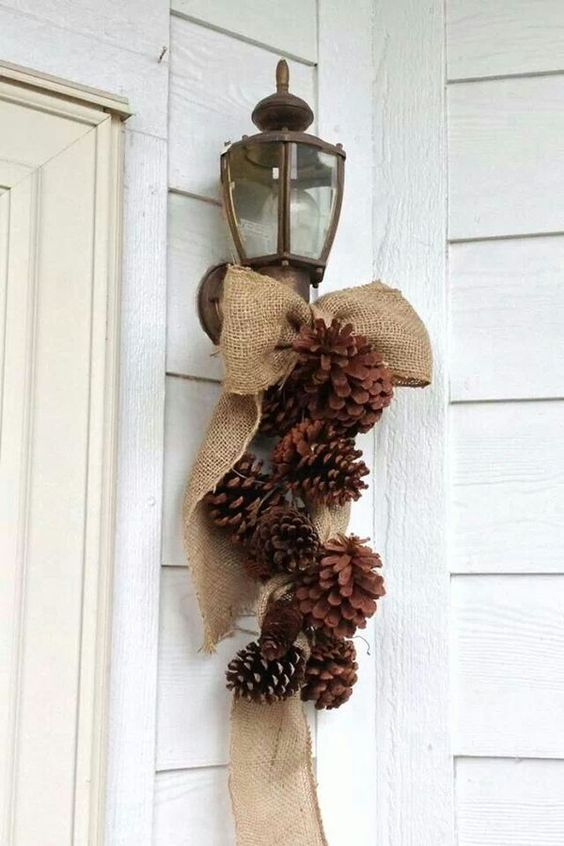 a burlap and pinecone decoration for outdoors can be made in a couple of minutes