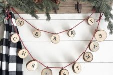 26 a wood slice letter garland can decorate any space, from an entryway to a living room