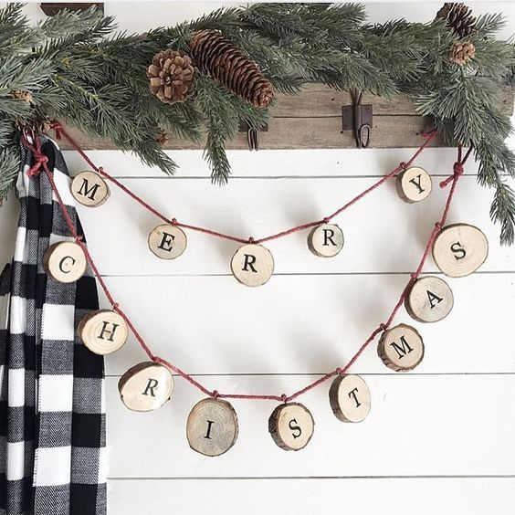 a wood slice letter garland can decorate any space, from an entryway to a living room