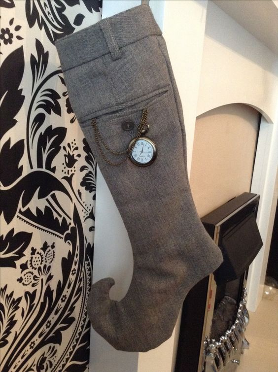 decorate large grey stockings looking like men elves' ones with vintage pocket watches