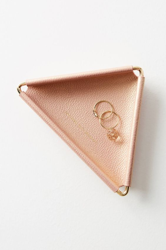 a triangle blush leather trinket dish with brass metal is a chic idea for any girl's space