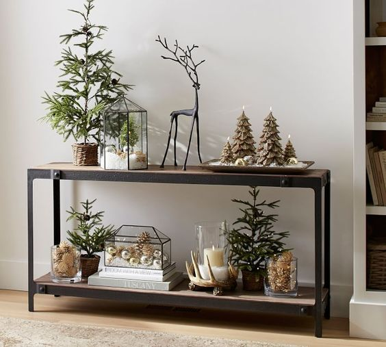 terrariums with faux snow and ornaments, evergreen trees in baskets and tree-shaped candles look quirky