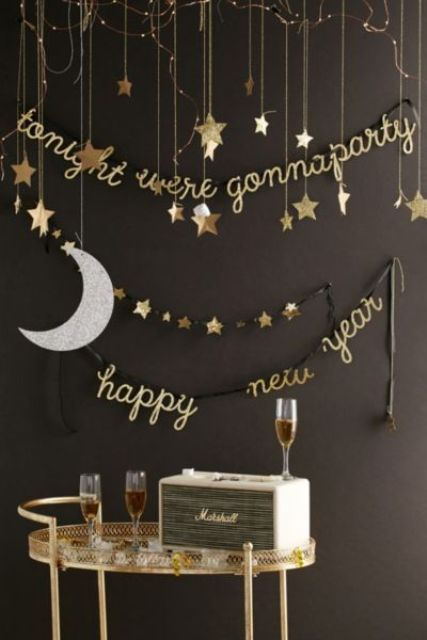 hanging stars, a moon and calligraphy garlands for decorating a drink station