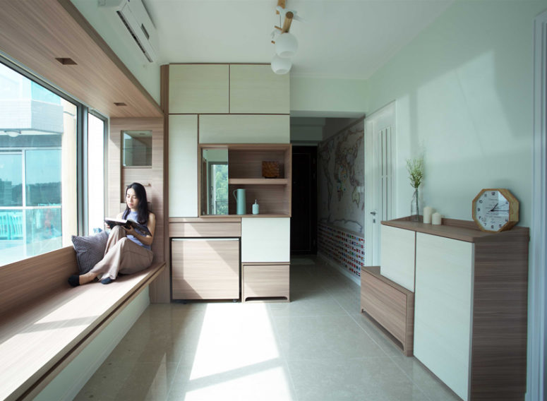 This minimalist apartment in Hong Kong is very functional and is built around bay windows
