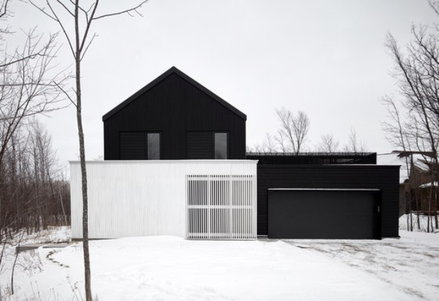 This modern chalet was inspired by local barns yet done in the modern black and white color scheme