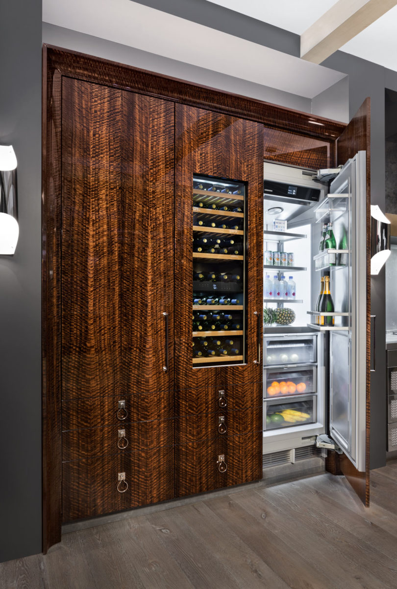 The fridges and wine freezers are fully covered with figured fumed eucalyptus