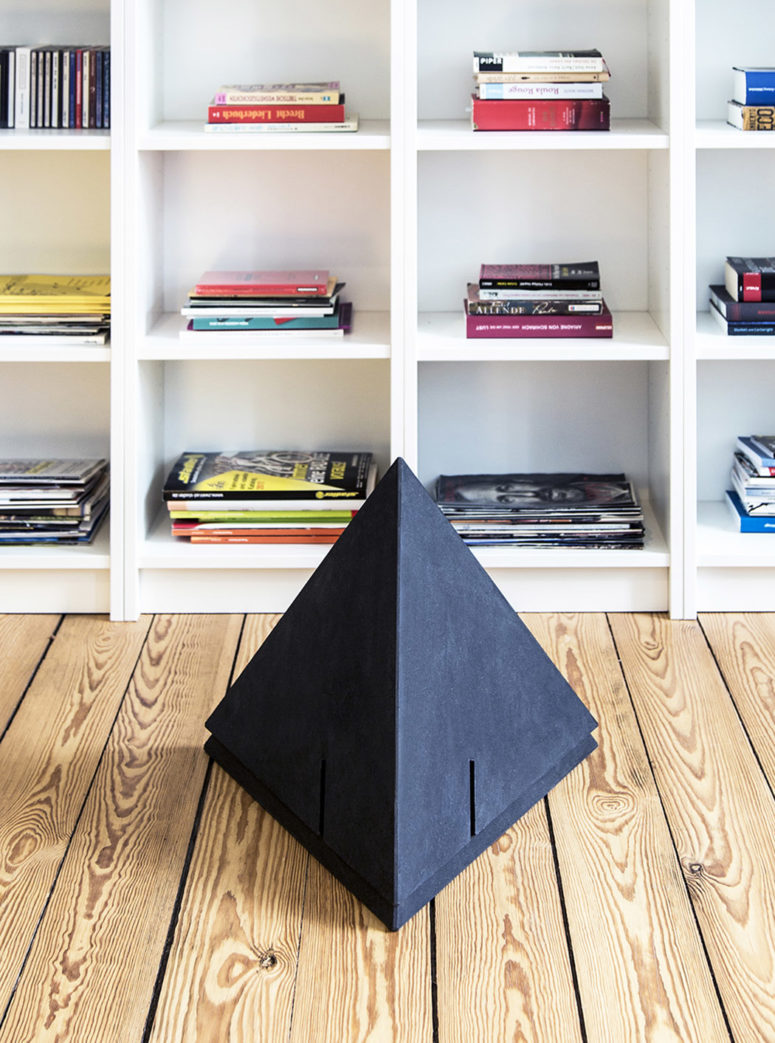The tables have a sculptural pyramidal shape and several cuts to place them as you like