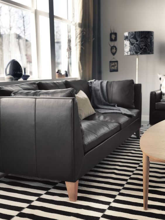 a black leather Stockholm sofa is a gorgeous and timeless idea, an ideal piece for a monochrome space