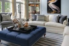 02 a large navy ottoman is a great fit for a beach or coastal space
