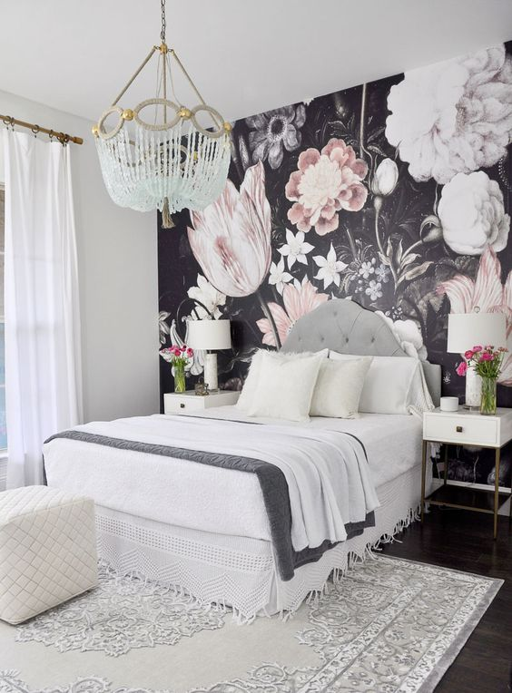 a statement wall for a girlish bedroom done with realistic floral wallpaper