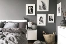 02 a stylish gallery wall with black and white pics for a monochrome space