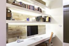 02 an ultra-modern workspace with lit up floating shelves and a desk for comfy working
