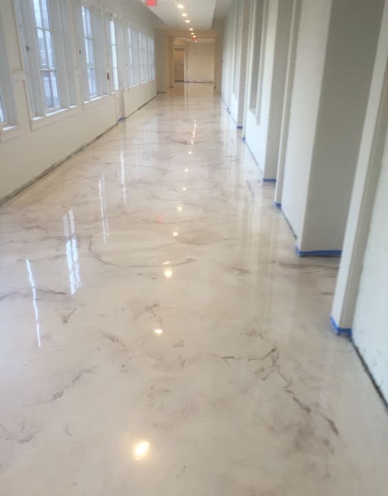 epoxy floors are often chosen for their amazing and bright look, here pearl metallic epoxy floors look wow