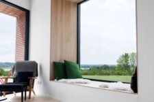 02 the focal point here is a large window with a windowsill daybed and gorgeous views