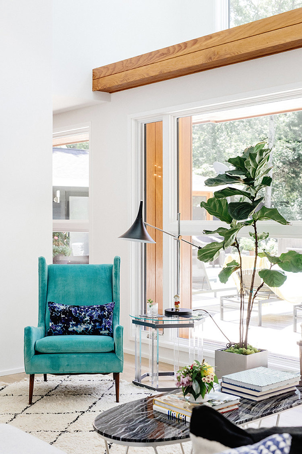 Potted plants and such touches like this turquoise chair enliven the space