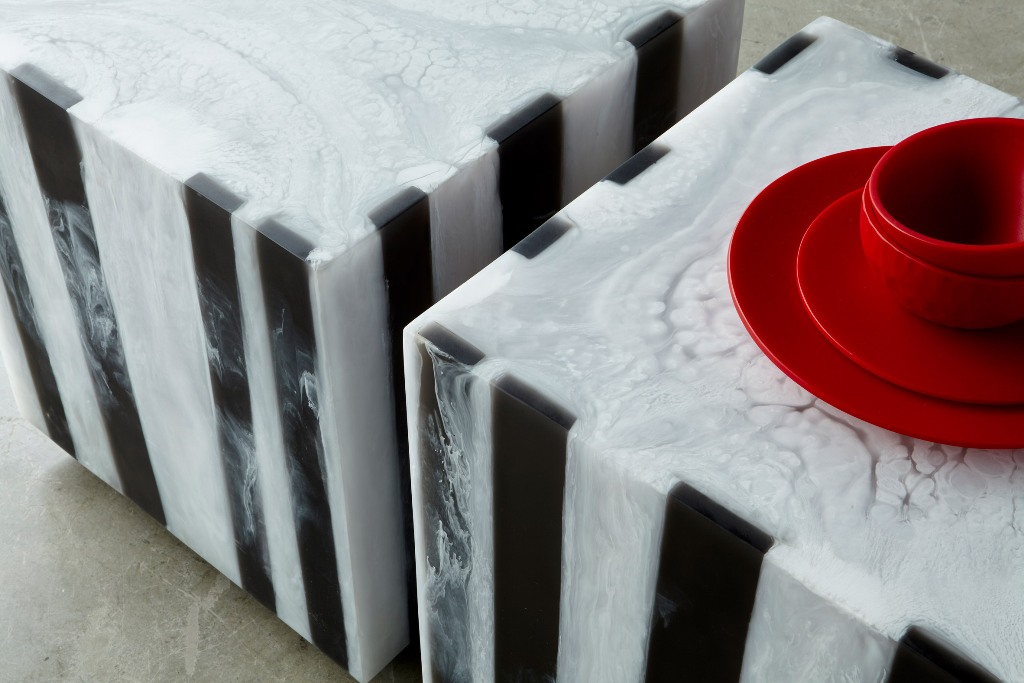 The Chief cube comprises a cube shaped stool with a black and white striped finish
