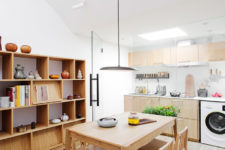 03 The kitchen is attic, with much light-colored plywood in decor, and there's a cozy dining space next to it
