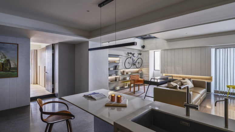 The most eye-catchy feature here is a set of shelves with owners' favorite things and a bike rack
