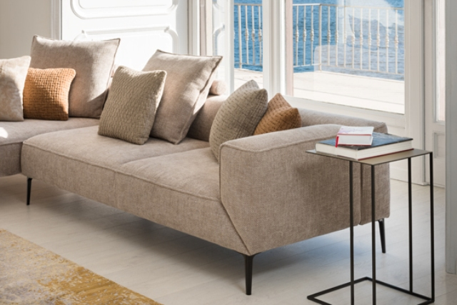 With soft tones and organic contours, high quality materials the sofa will be welcome in your living room