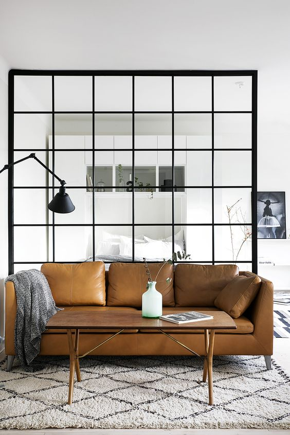a Stockholm sofa in tan leather looks ideal in a light-filled Scandinavian space