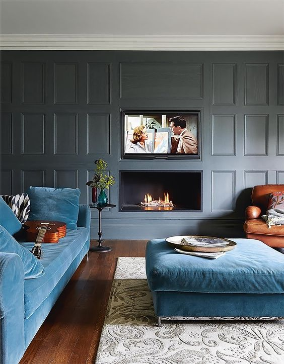 a large blue upholstered ottoman that matches the sofa is a way to add more coziness