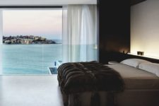 03 a spacious masculine bedroom with a gorgeous sea view