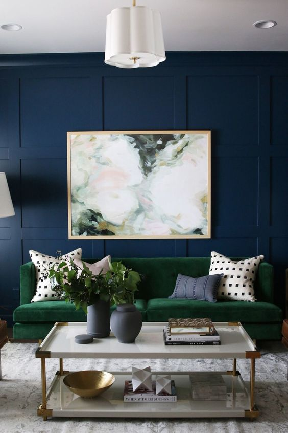 a watercolor abstract artwork contrasts the jewel tones of the room