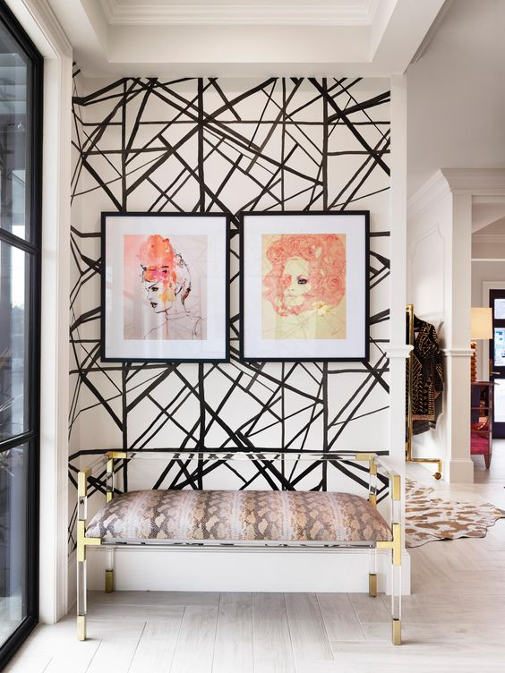 an entryway with a black and white geometric wall as a bold accent